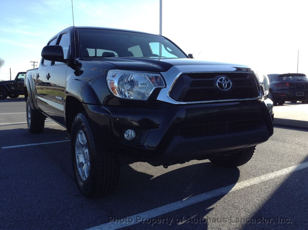 Pre-Owned 2013 Toyota Tacoma 4WD Double Cab LB V6 Automatic